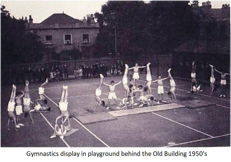 Gymnastics display in playground behind the old building 1950s