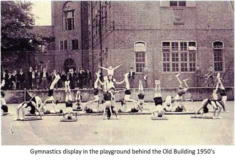 Gymnastics display in the playground behind the old building 1950s