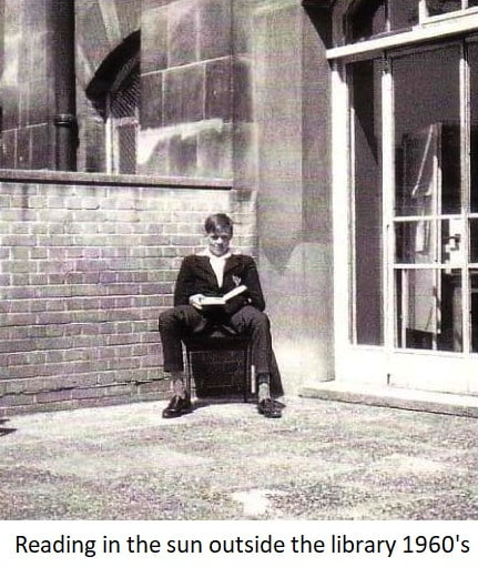Reading in the sun outside the library 1960s